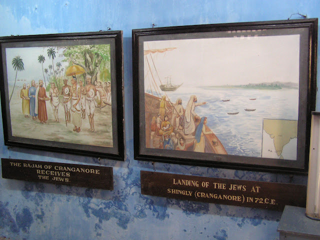 Photos on diplay inside the old Jewish synagogue in Cochin - showing arrival in Kerala