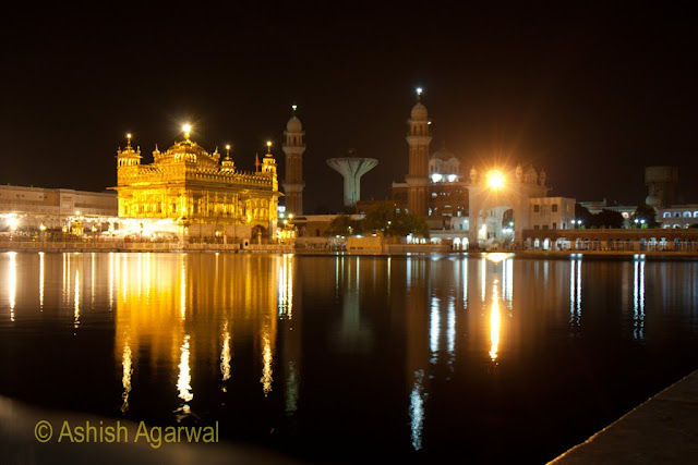 View of the Golden Temple in Amitsar from an angle, along with a view of minarets in the back