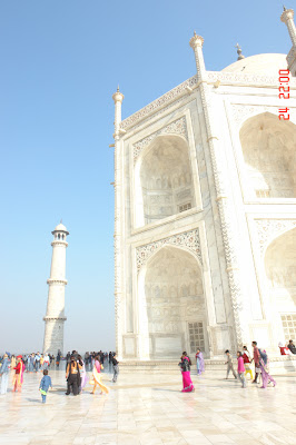 Section of the Taj Mahal and a minaret