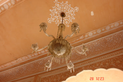 An ornate chandelier hanging inside the Jaipur city Palace