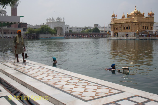 Volunteers cleaning the tank of the Golden Temple in Amritsar