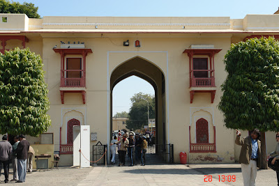 Tourists entering the symmetrical archway of the Jaipur City Palace