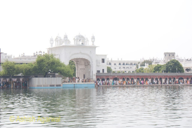View of one of the entrances to the Golden Temple compound along with a number of devotees in the city of Amritsar
