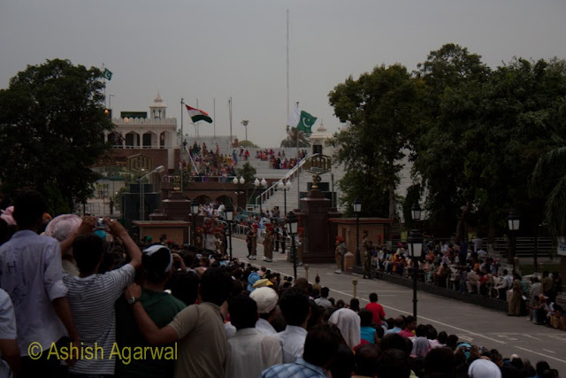 The Pakistani and Indian flags starting to be pulled down at the Wagah Border between India and Pakistan