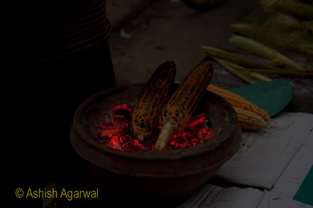 Selling roasted corn to tourists close to the Wagah border between India and Pakistan
