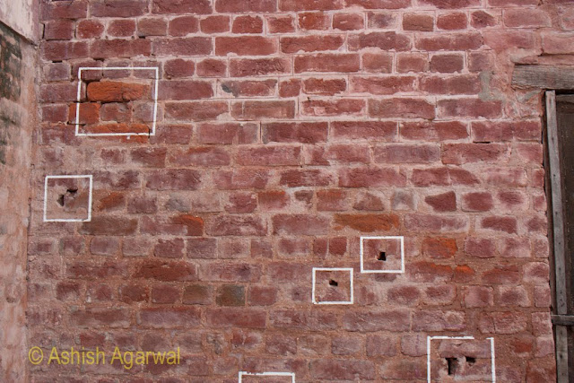 Bullet marks on the rear wall of the Jallianwala Bagh memorial at Amritsar