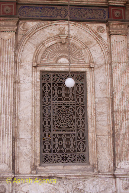 Saladin Citadel in Cairo - view of the metal lattice of a window along with a lamp