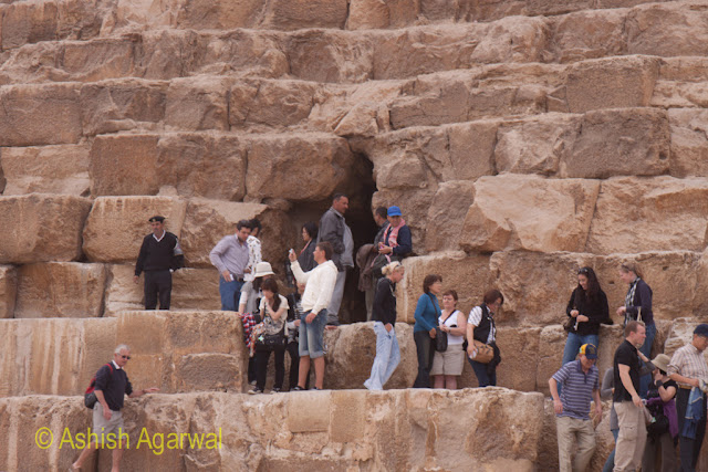 Cairo Pyramids - People at the entrance to the burial chamber