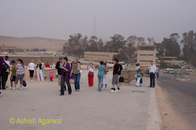 Egypt Pyramids - Tourists heading towards the pyramids from their tour buses