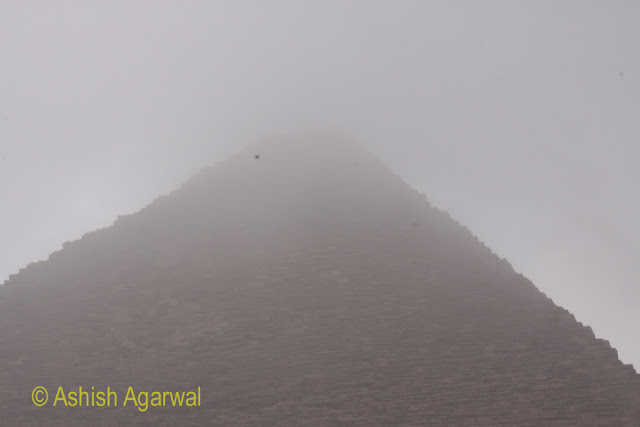 Cairo Pyramids - The Great Pyramid obscured to a large extent by fog