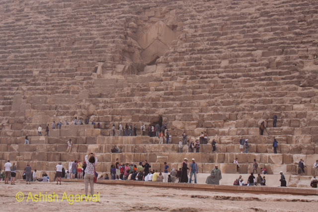 Cairo Pyramids - Tourists at the base of the Great Pyramid