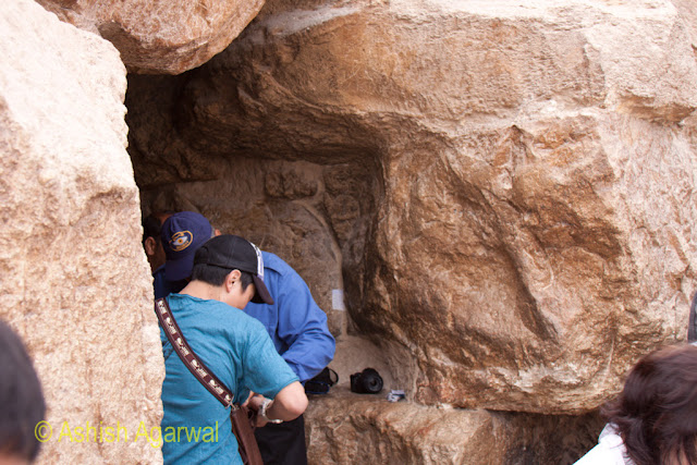 Cairo Pyramids - Tourist getting ready to enter the Great Pyramid in Giza through the Robbers Tunnel