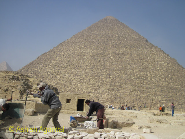 Cairo Pyramids - Workers carrying out some restoration work at the Great Pyramid in Giza
