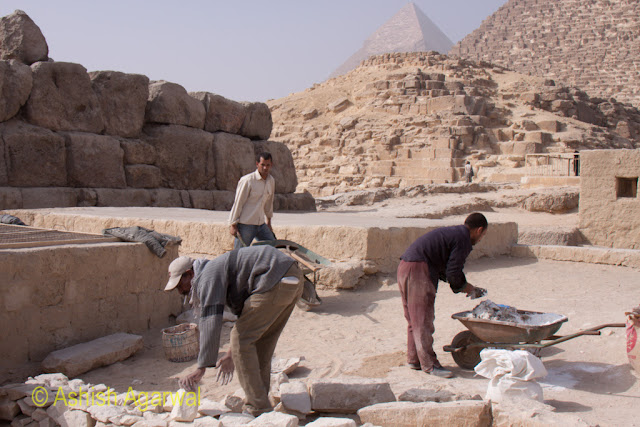 Cairo Pyramids - Workers involved in the restoration going about their work right next to the Great Pyramid