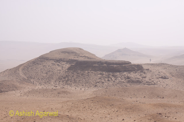 Cairo Pyramid - the hillock near the Cairo Pyramids, with the desert being visible, and a camel in the distance