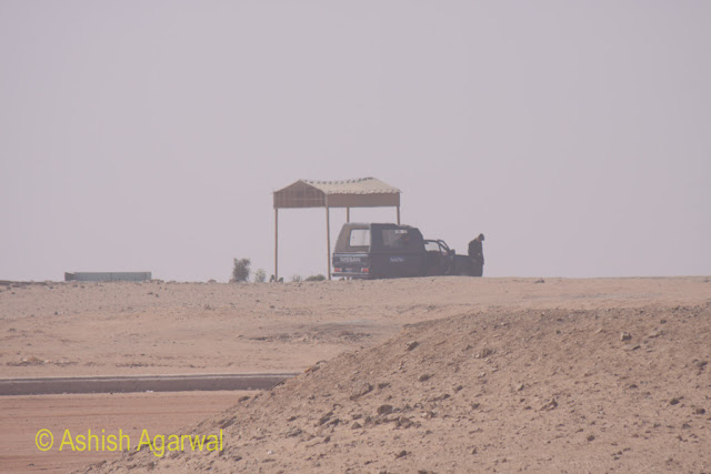 A security post and police vehicle at the Panorama point in Giza, near the Great Pyramids