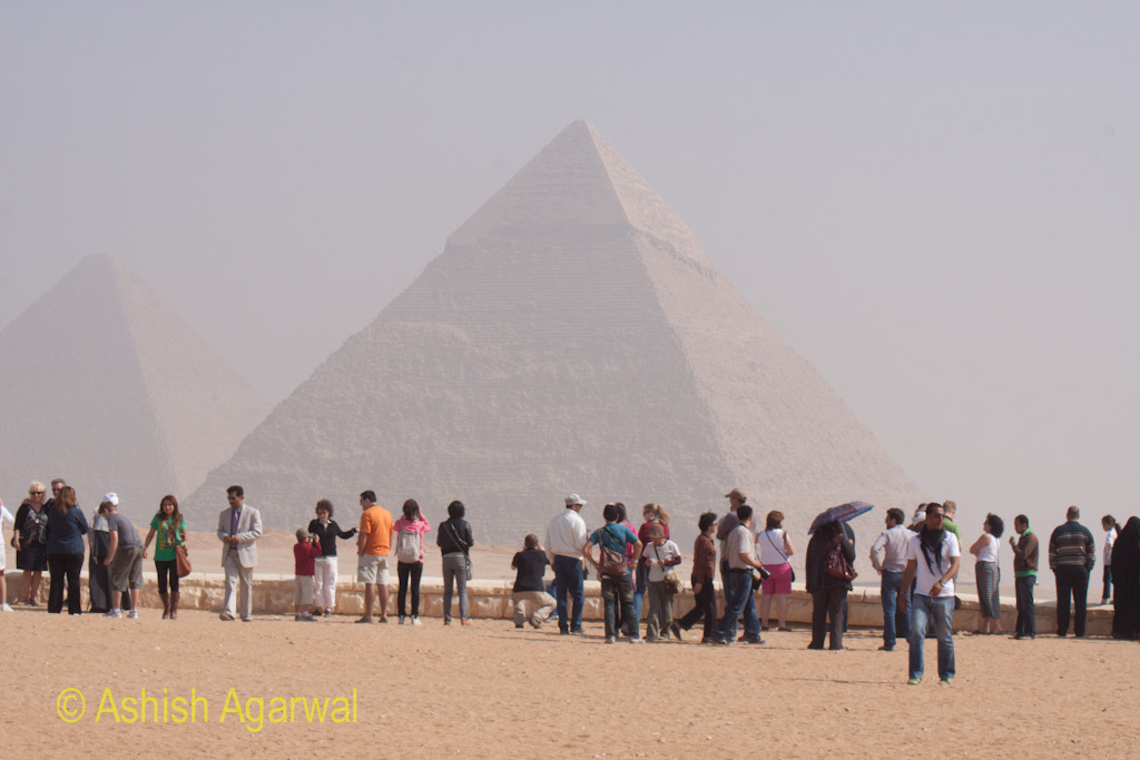 Tourists, seen against the backdrop of the Great Pyramid, at Giza in Egypt