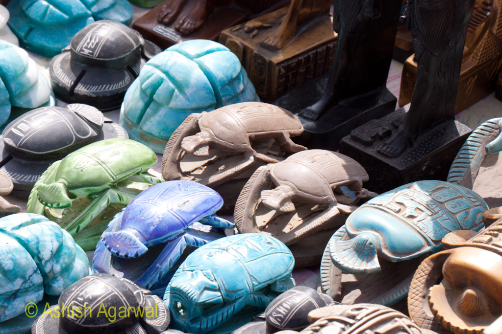 Stone replicas of sacred beetles being sold at the Panorama Point in Giza