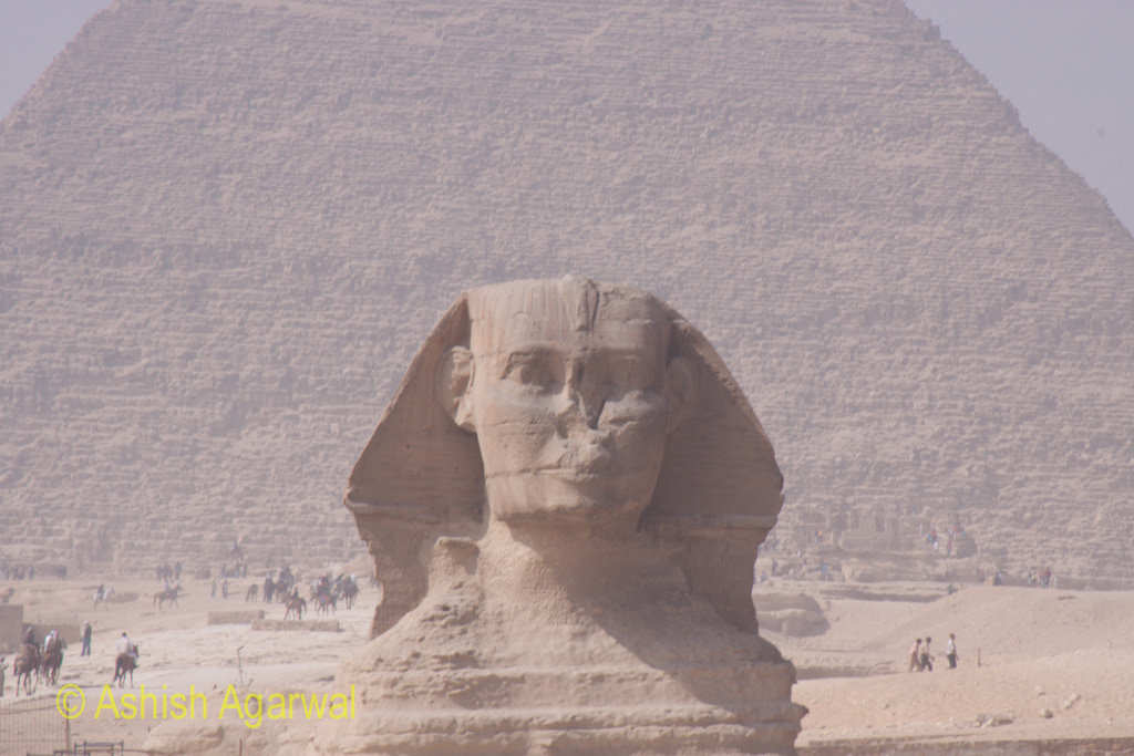 View of The Sphinx, with the base of the Great Pyramid in the background