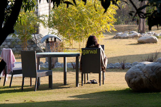 A lady soaking the sun inside the Club Mahindra resort at Corbett National Park