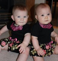 [twins+in+skirted+onesies]