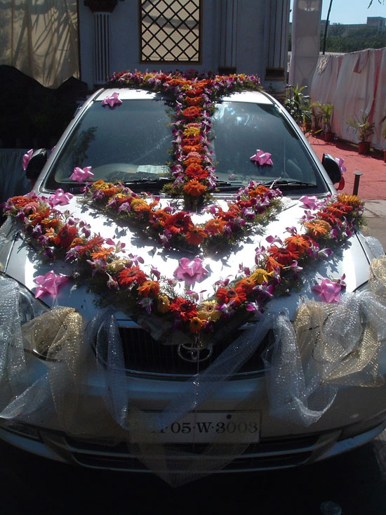 Perfect Wedding Car Decorations Flowers 550 x 733 · 117 kB · jpeg