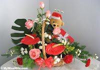 send christmas flower basket