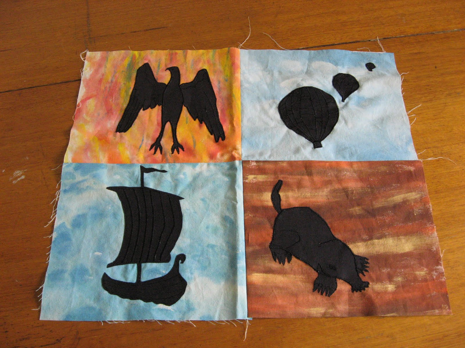 symbols are appliqued onto dyed fabric to represent Earth Wind Water ...