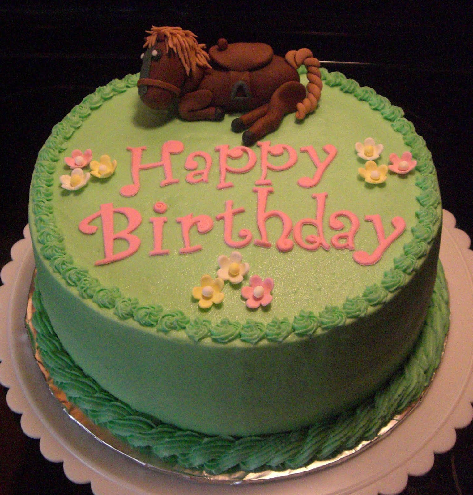 Summers cake place horse lovers birthday cake this is a 9 inch chocolate cake with vanilla buttercream the horse is made out of fondant and the flowers are made out of gum izmirmasajfo