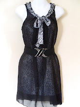 A 1023 - Animal print dress (belt not included), fits size S,M