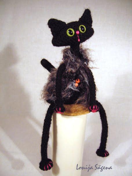tamborēts melns kaķis,vestes kaķis,lofonsa