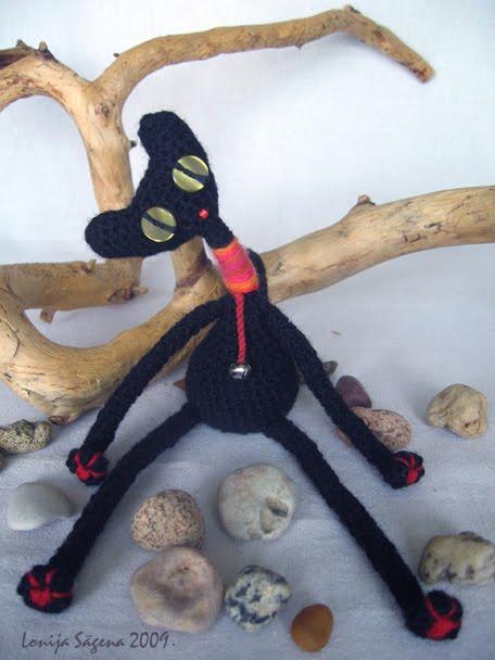 tamborēts melns kaķis,sliņķis,lofonsa
