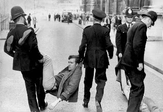 Police carry off a potential troublemaker!
