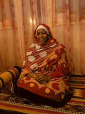 Beautiful Nubian Lady sitting on a traditional Nubian Mat-Birish