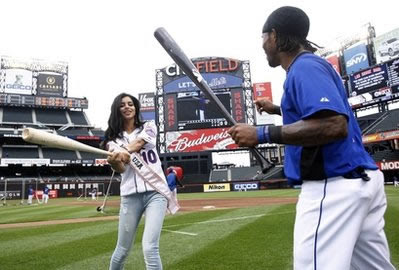 Miss USA RIma Fakih looking cute and sexy playing baseball