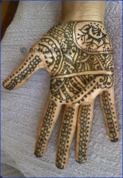 Here is a photo of a full palm henna tattoo Henna always gives the reddest