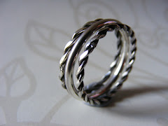 Set Of Three Narrow Silver Rings, One Plain, Two Twisted.