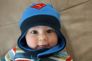 Baby T in his Superman Hat