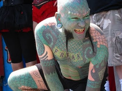 Oh and this guy is almost completely covered in the lizard tattoo design now