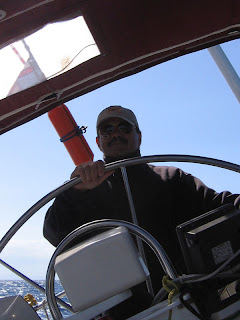 Me at the helm fighting the 'Meltemi' winds on our way to Andros