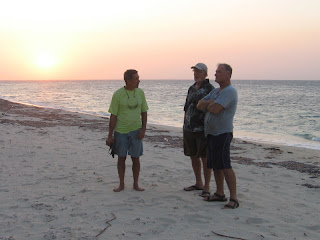John, Eric and Capt. John on Camp Bay Beach (Note all the plastic bottles!)