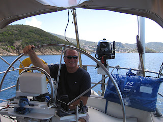 Captain John smiling from the helm as we depart St. Thomas