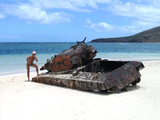 Nan posing with a rusted military tank on Flamenco Beach