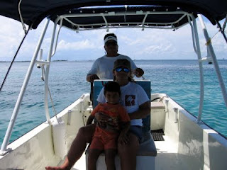 Ariel and his family in their panga on Isla Mujeres