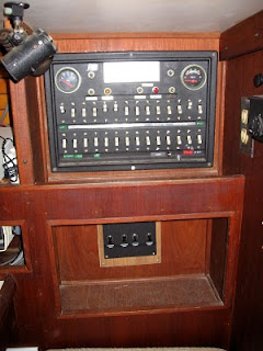 Original Uniflite electrical panel next to navigation station--switches below control lights on deck