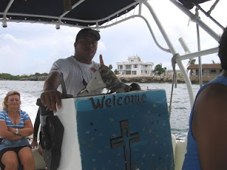 Rosi and Ariel on the boat as we pass 'the white house' at Sac Bajo on Isla Mujeres