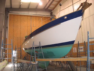 Whispering Jesse showing off her new Awlgrip hull paint
