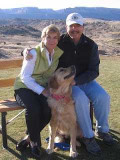 Christmas card photo 2010: Nan, Scout and John at Redlands Mesa Golf Club with the Colorado National Monument in the background
