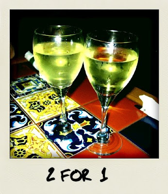 two glasses of wine. she brought me two glasses of