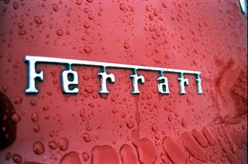 ferrari logo with rain drops on it
